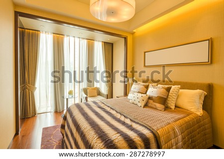 luxury hotel bedroom with upscale furniture and modern style decoration