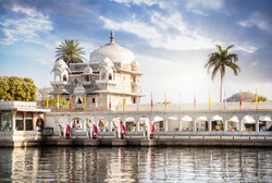Luxury hotel on the Pichola lake at blue cloudy sky in Udaipur, Rajasthan, India