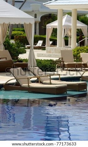luxury hotel resort pool, chairs and patio