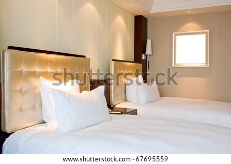 Luxury hotel rooms, clean and bright.