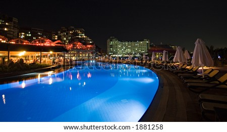 Luxury hotel swimming pool at night