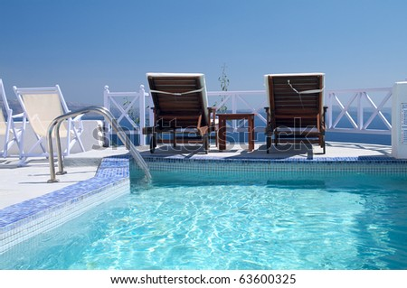 Luxury hotel swimming pool with sea view