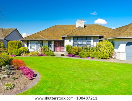 Luxury house with nicely landscaped front yard.