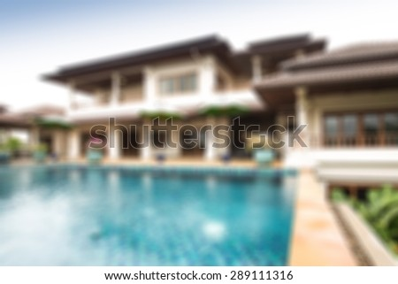 luxury house with pool blurred background
