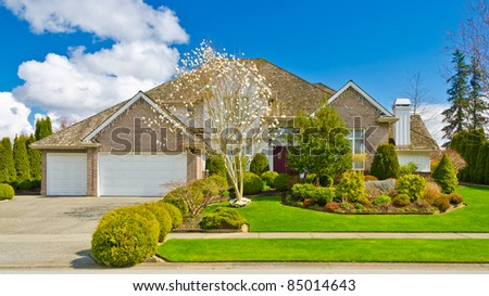 Luxury house with triple garage on sunny spring day in Vancouver, Canada. - stock photo