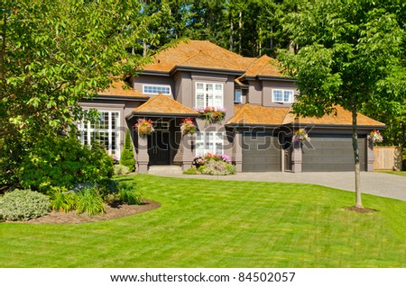 Luxury house with triple garage on sunny summer day in Vancouver, Canada.