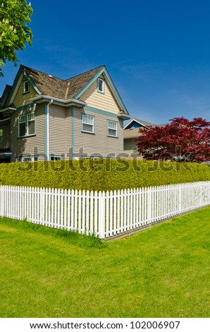 Luxury houses with white fence in Vancouver, Canada. - stock photo