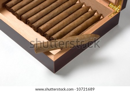 Luxury humidor with torpedo hand-rolled cigars in a maduro leaf wrapper.