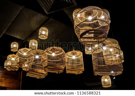 luxury indoor lighting using bird cages and bare light bulbs
