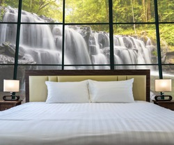 Luxury Interior bedroom with windows glass beside Beautiful waterfall in the deep forest, relax and holiday concept, dicut each elements.