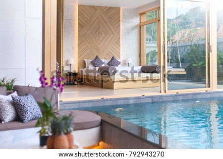 Luxury Interior design in bedroom of pool villa with cozy king bed with high raised ceiling  #792943270