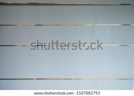 luxury interior wall, a taupe color wooden lath with golden trim #1507882793