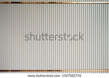luxury interior wall, a taupe color wooden lath with golden trim #1507882796
