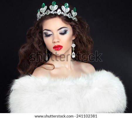 Luxury Jewelry. Fashion woman in white fur coat, lady portrait isolated on black background.