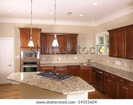 Luxury kitchen corner with island stove stock photo - french