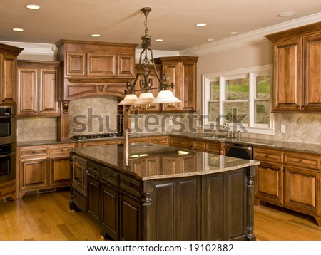 Luxury Kitchen with Center Island with three lights - stock photo