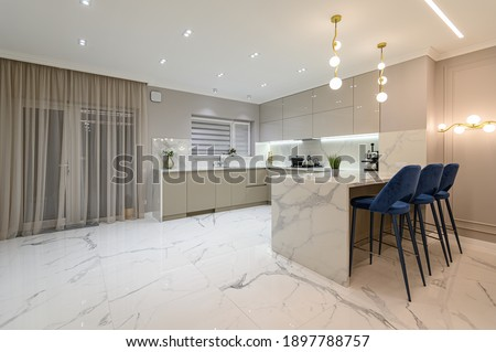 Luxury large modern white marble kitchen united with dining room and living room Сток-фото ©