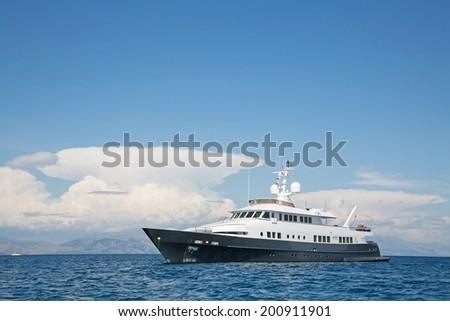 Luxury large super or mega motor yacht in the blue ocean.