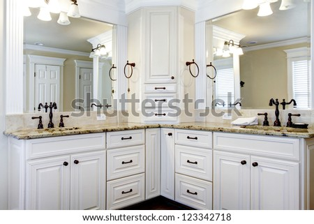 Luxury large white master bathroom cabinets with double sinks.