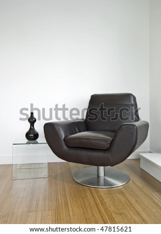 luxury leather armchair with glass side table and decoration