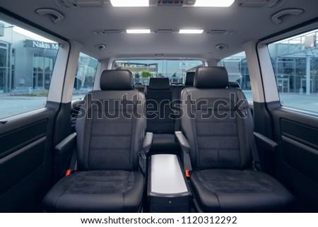 Luxury leather seats in the van. Interior of luxury minivan.