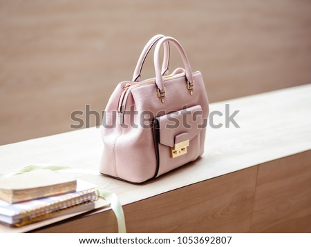 Luxury light pink handbag in saffiano leather with modern style