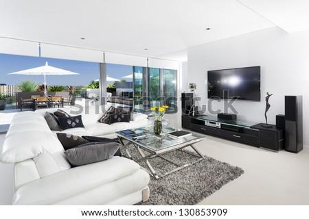 Luxury living room and balcony - stock photo
