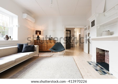 Luxury living room interior styled in contemporary furnishings with fire place