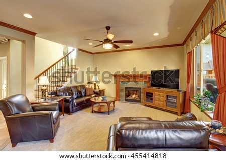 Luxury Living Room Interior With Fireplace And Carpet Floor. Black Leather  Sofa And Armchairs,