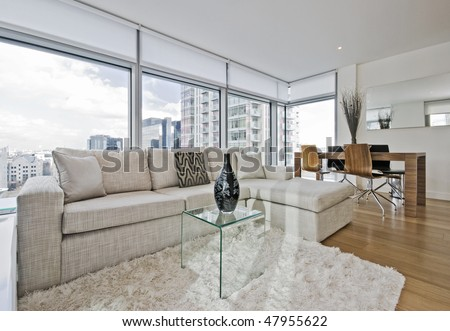 luxury living room with floor to ceiling windows - stock photo