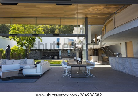 Luxury living room with large bay windows and patio.