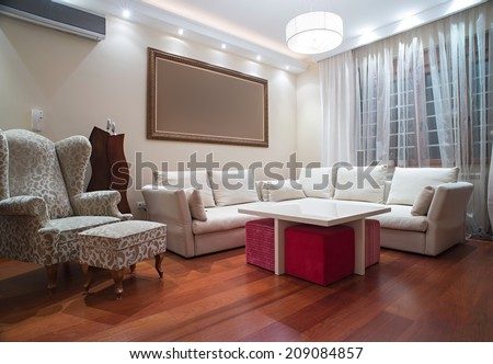Luxury living room with modern ceiling lights - evening shot