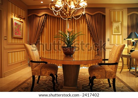 Luxury living room with table and two chairs