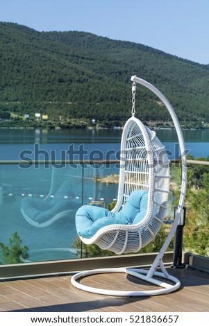 luxury lounge swing chair  with beautiful sea view   #521836657
