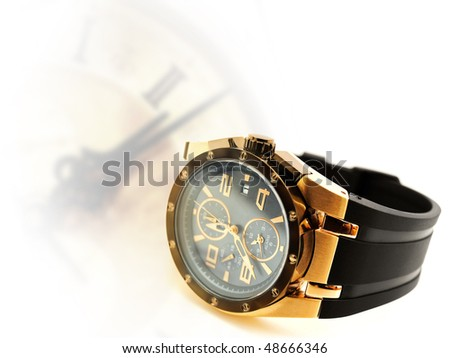 luxury man watch against vintage clock silhouette. Copyspace for your text