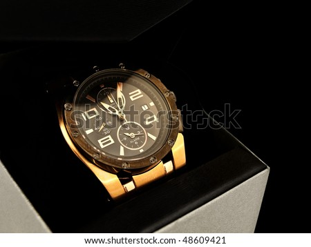 luxury man watch in gift box against black background