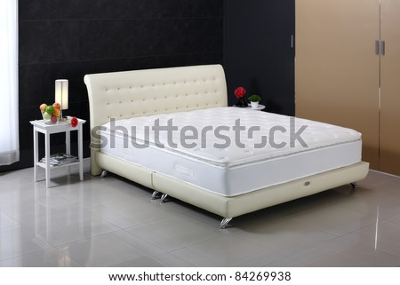 Luxury mattress and bedding set in an interior bedroom