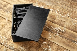 Luxury men outfits in black box on wooden background