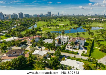 Luxury Miami Beach mansions on golf course landscape #1481809643
