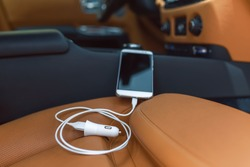 Luxury mobile phone car charger close up