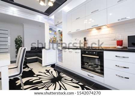 Luxury modern black and white kitchen with carpet on floor