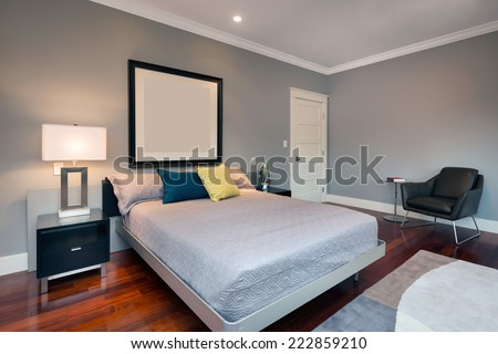 Luxury modern home bedroom. King size bed with hand-woven natural colored fine sisal runner, rug.