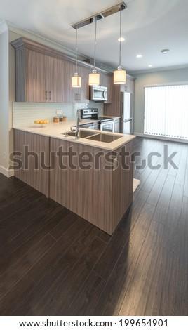 Luxury modern kitchen in a brand new house. Interior design. Vertical.