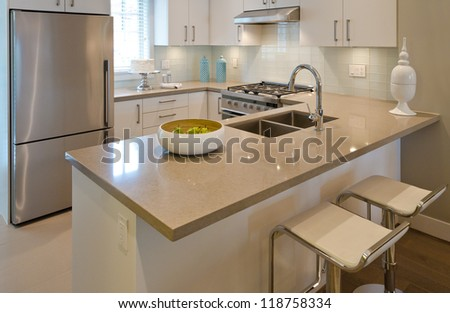 Luxury Modern Kitchen With The Dish With Some Pears On The Counter. Interior Design