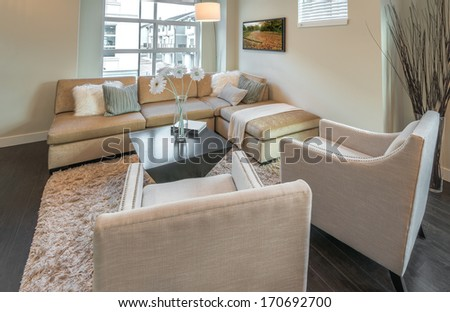 Luxury modern living suite, room with sofa and chairs.  Interior design of a brand new townhouse.