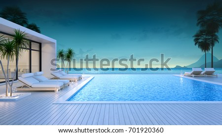 Luxury modern style at the exterior beach houses with a private swimming pool,beach lounge at evening,summer paradise ,Lounge of the breathtaking view sea and sky/3d rendering #701920360