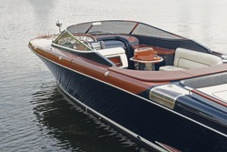 Luxury motor boat at the pier. Transport