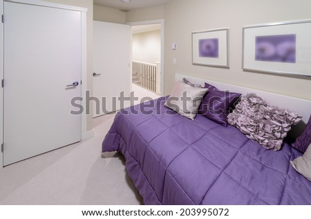 Luxury nicely decorated modern bedroom.  Interior design of a brand new house.