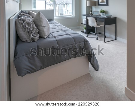 Luxury nicely decorated modern comfortable bedroom.  Interior design of a brand new house.