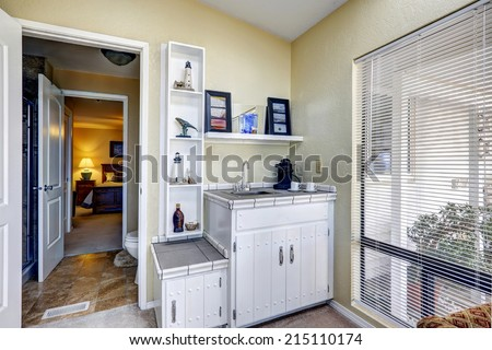 Luxury office room with leather chair, wooden desk  and cabinets